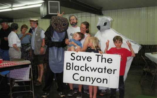 "group of people with a sign that says ""Save the Blackwater Canyon"""
