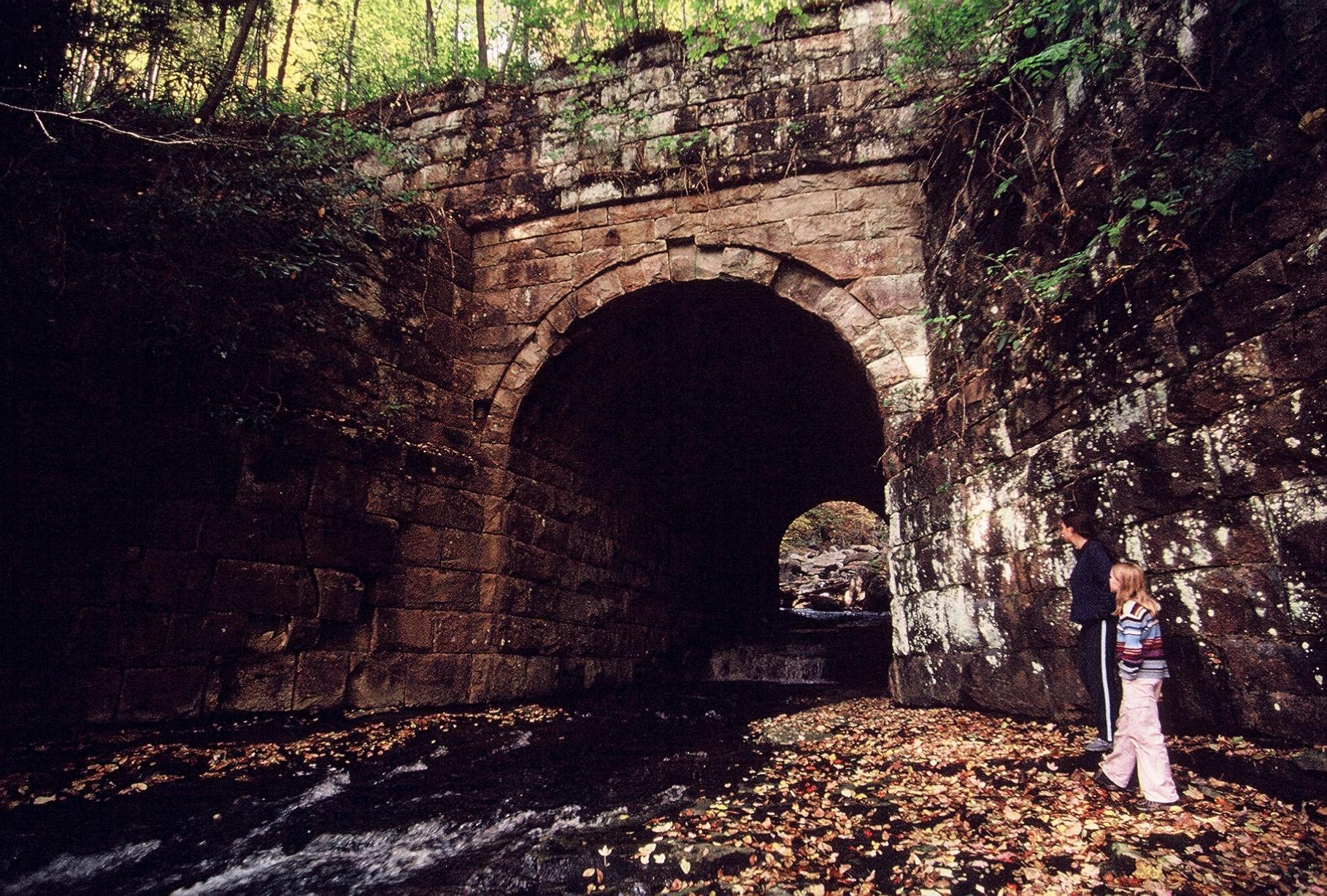 railroad bridge arch along rail trail