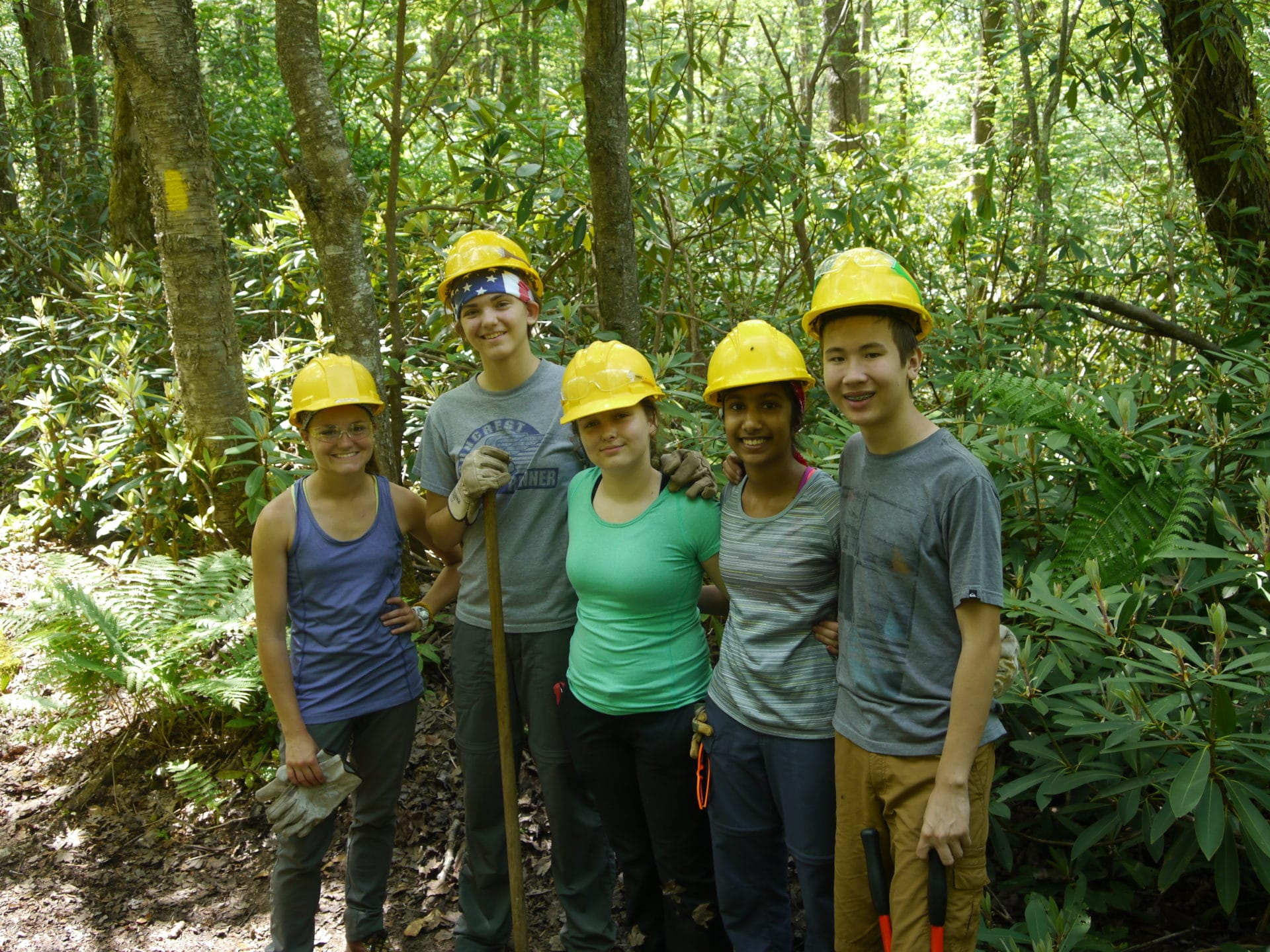 young trail volunteers take a break