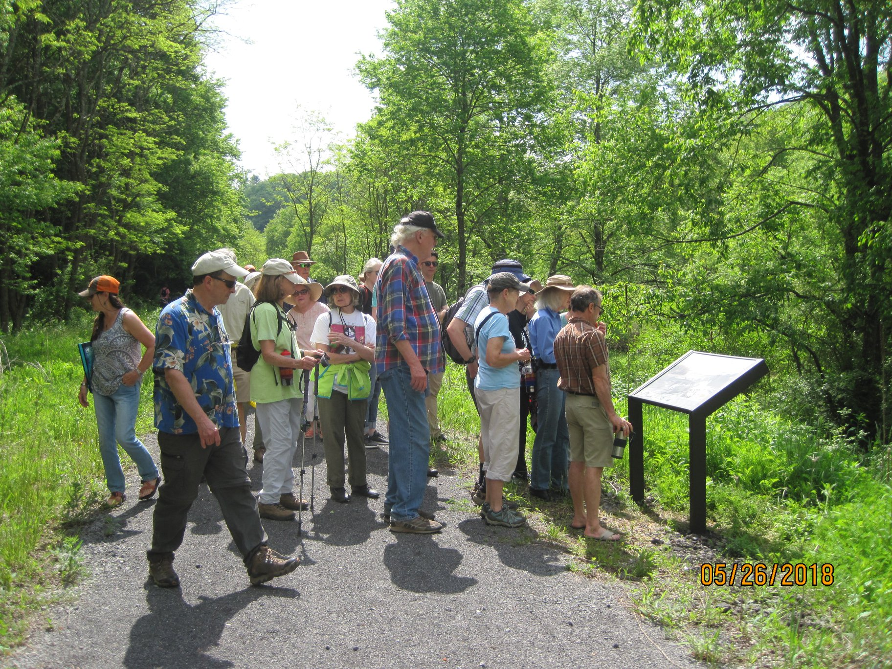 history hike participants admiring new sign