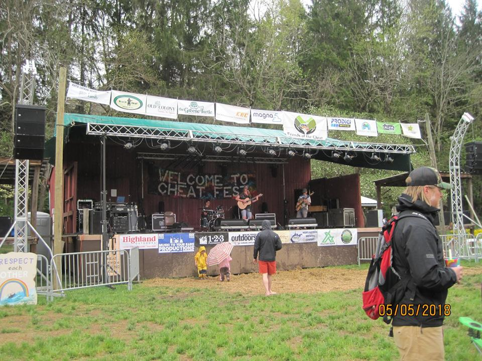 musicians performing on the festival stage at Cheat Fest