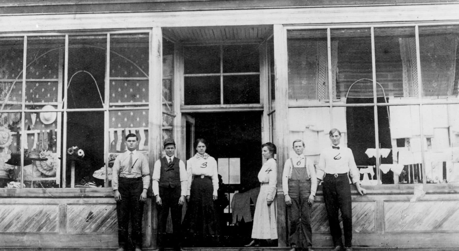 six people standing outside of DePollo's Store in Thomas in 1914