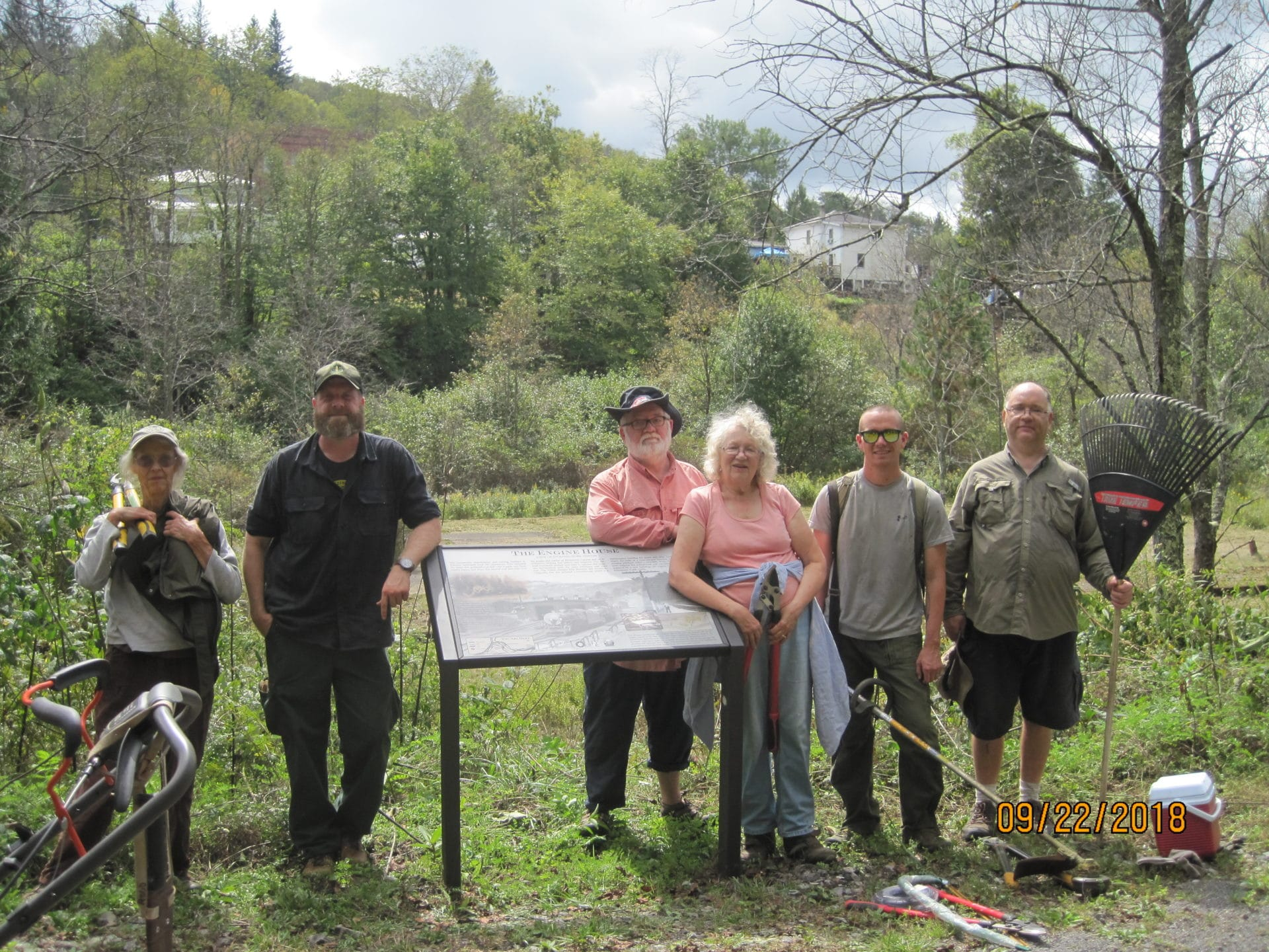 volunteers who have been cleaning up the historic roundhouse foundation along the rail trail