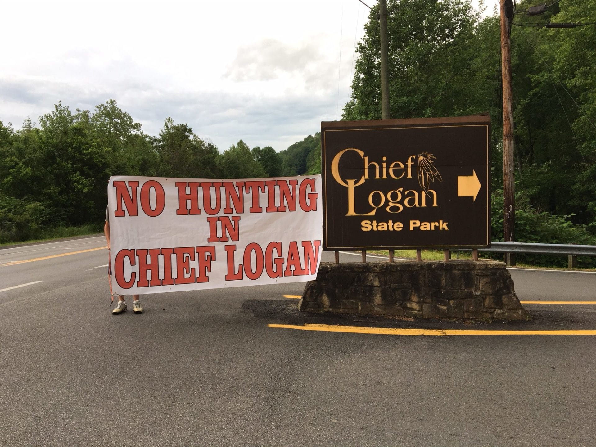 "a sign reading ""no hunting in Chief Logan"" at the entrance to Chief Logan State Park"